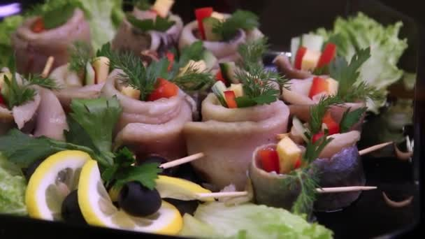 appetizers fish in the form of rolls with vegetables and herbs