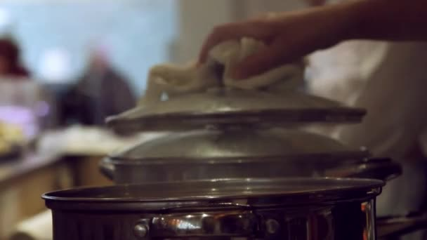 Close up of hands chef opens the pot filling pan with water and close the lid at kitchen
