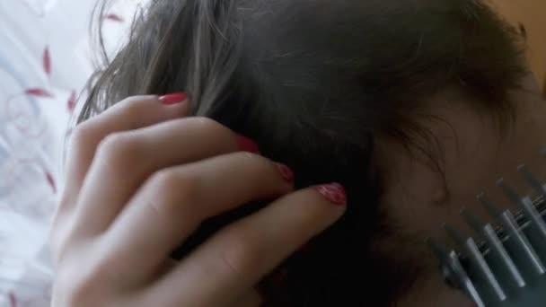 Detailní záběr Pánská účes s clipper v holičství. Makro