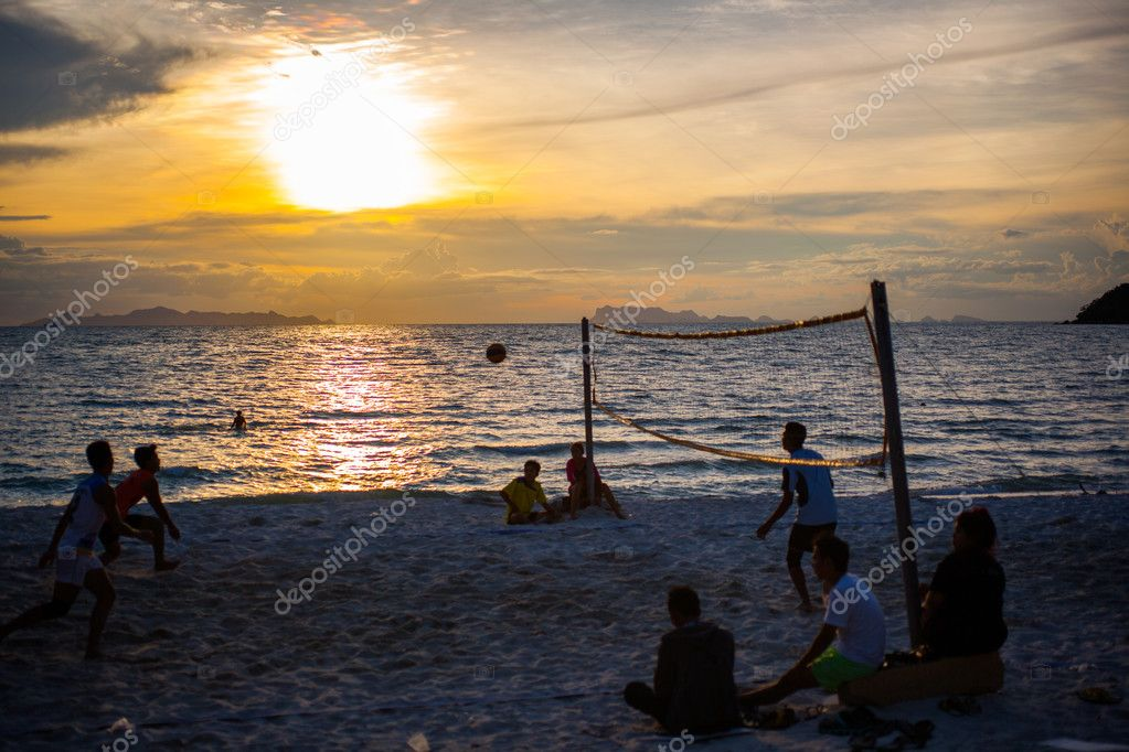 Volleyball game at Koh Samui Pier in amazing sunset, Thailand