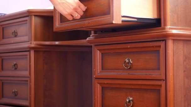 Women hand open old wooden  antique chest of drawers  with metal handles in slowmotion