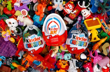 Big heap of Kinder Surprise toys and eggs.