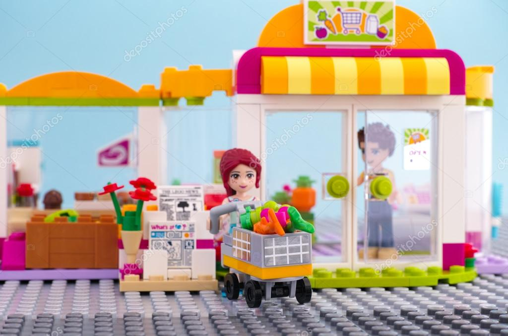 Lego girl with trolley of food came out from supermarket. – Stock ...