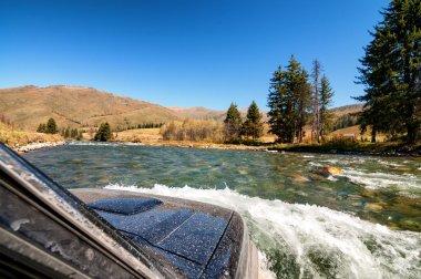 Crossing mountain river in the Kazakhstan