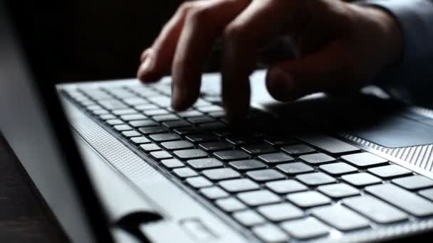 Man hand typing on a computer keyboard