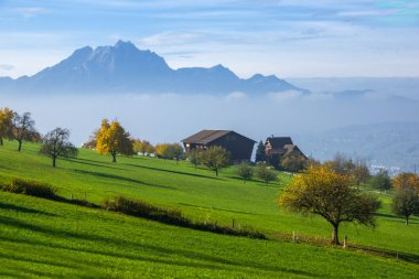 Amazing Landscape of Mount Pilatus and Lake Lucerne covered with frog, Alps