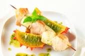 Chicken and aubergine skewer with pesto and horned melon