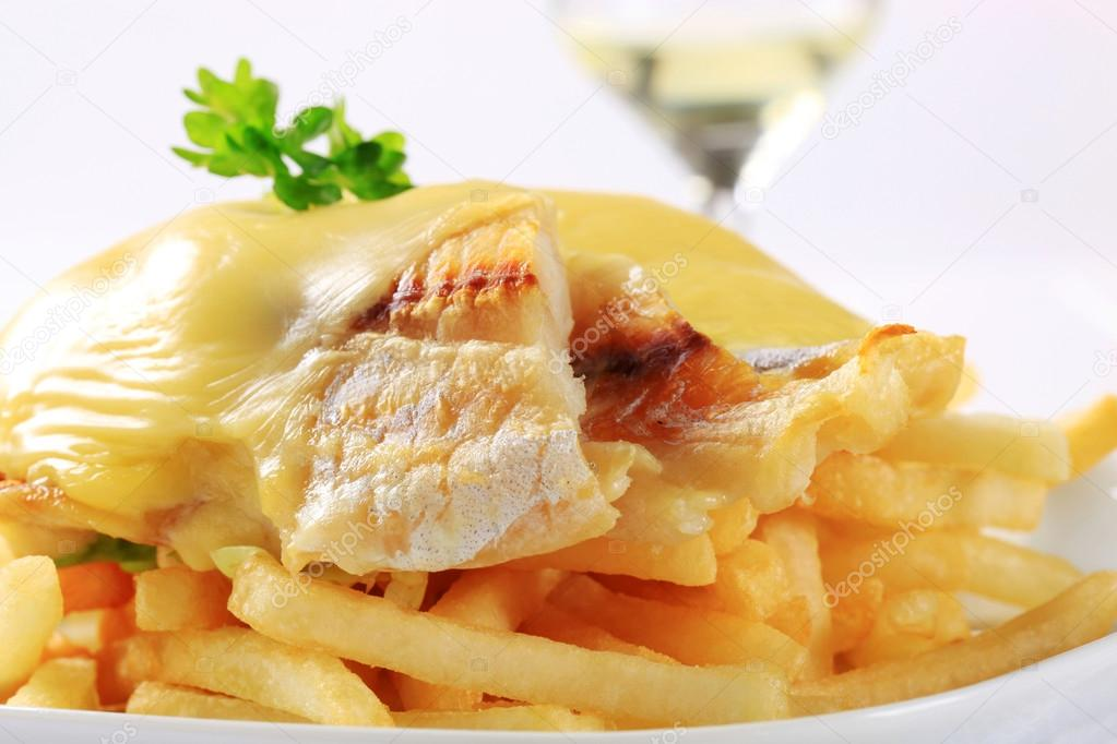Cheese topped fish fillets with French fries
