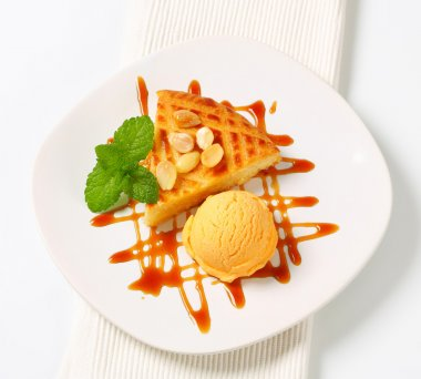 Almond cake with ice cream and caramel sauce