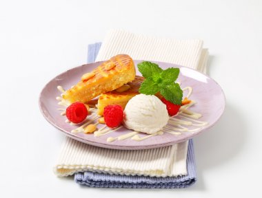 Almond cake with ice cream and raspberries