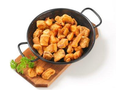 Crispy fried pork greaves