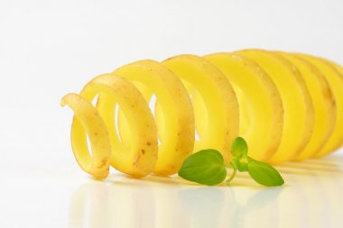 raw spiral cut potato