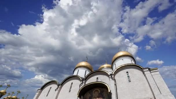 Assumption Cathedral(Cathedral of the Dormition,Uspensky sobor) against the moving clouds. Inside of Moscow Kremlin, Russia (day)