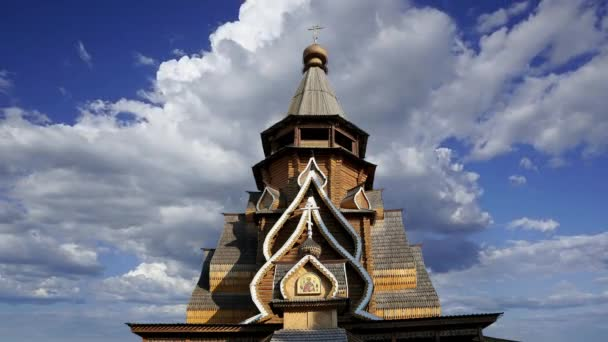 Church of St. Nicholas in Izmailovsky Kremlin (Kremlin in Izmailovo) against the moving clouds, Moscow, Russia. The new church, built in the traditions of Russian wooden architecture