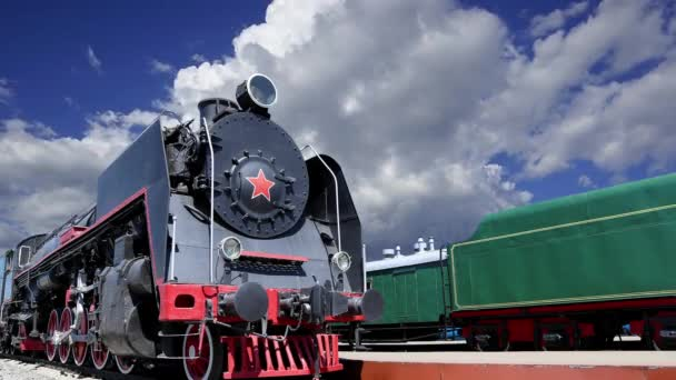 Ancient steam locomotive against the moving clouds, Moscow, Russia