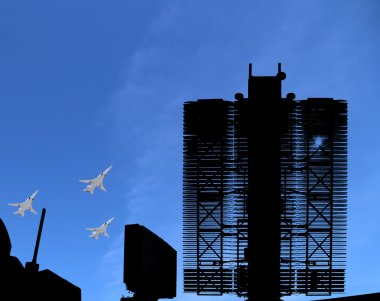 Modern Russian radar and military aircrafts fly in formation against the sky