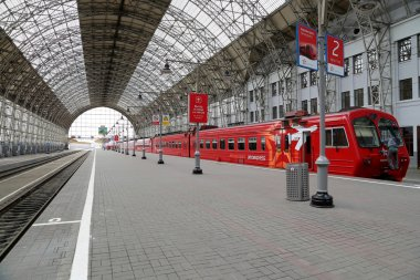 Aeroexpress red Train on Kiyevskaya railway station  (Kiyevsky railway terminal,  Kievskiy vokzal) -- is one of the nine main railway stations of Moscow, Russia