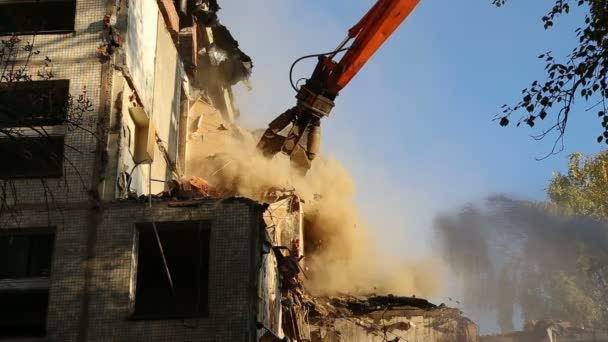 Hydraulic crusher excavator machinery working on demolition old house