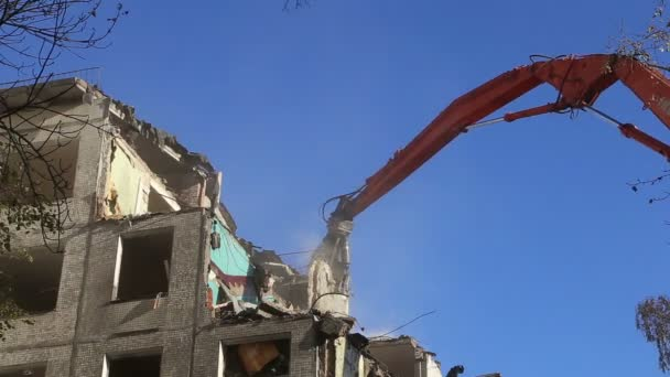 Hydraulic crusher excavator machinery working on demolition old house.Moscow, Russia