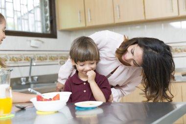 Lovely  Mother and her children having breakfast