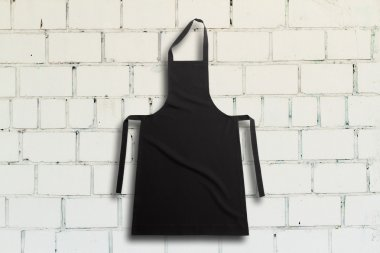 Apron on white brick wall