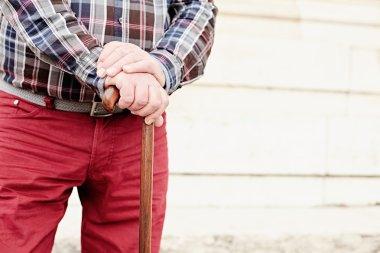 Man with cane closeup