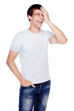 Laughing guy with hand on face