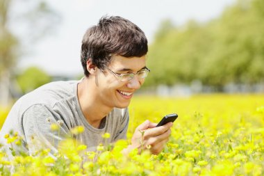 Guy reading from mobile phone