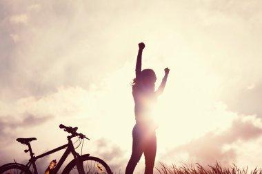 Winning girl with bike silhouette