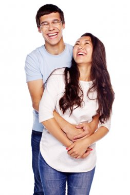 Laughing couple hugging