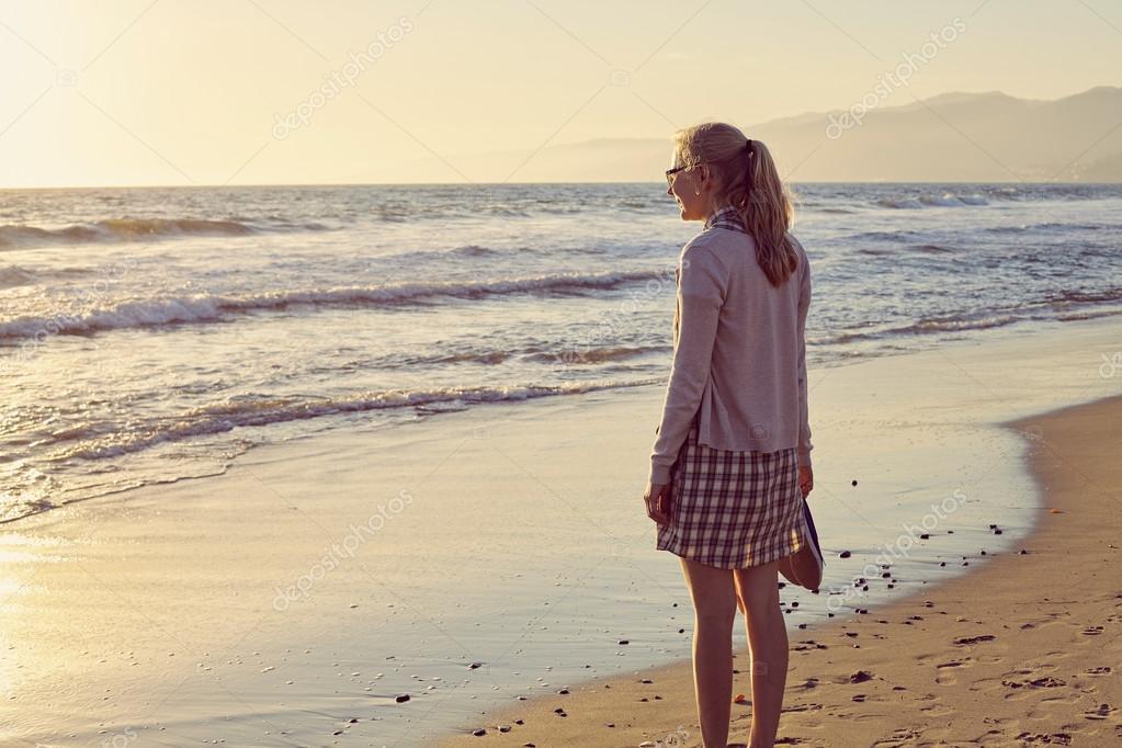 Girl on foggy beach