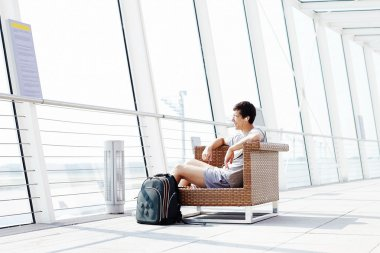 Guy resting in airport lounge