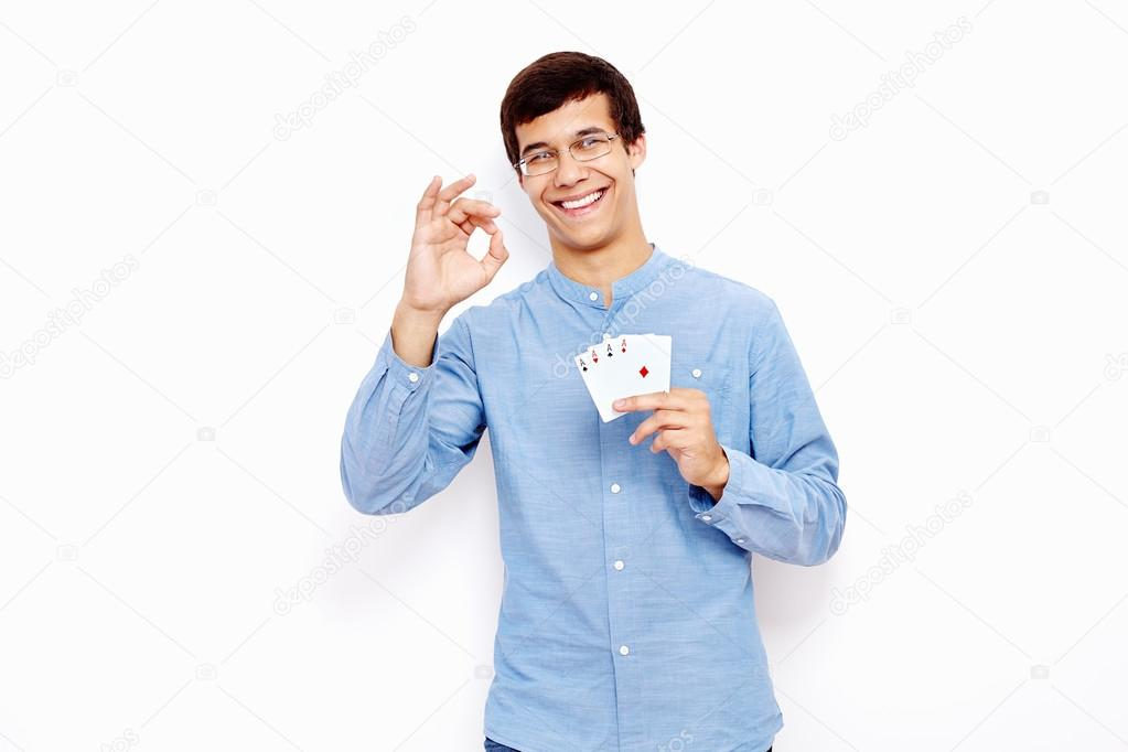 Guy with cards and okay sign