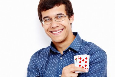 Smiling guy with playing cards
