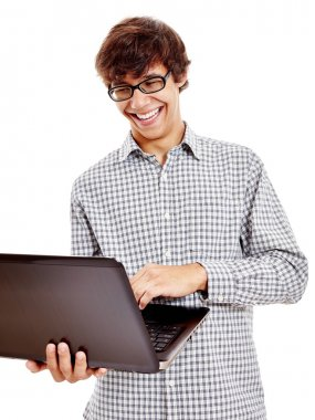 Guy laughing with laptop