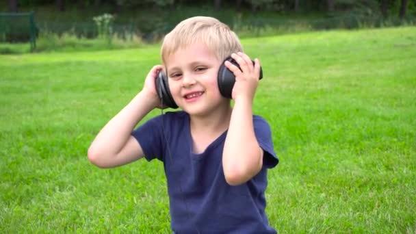 boy listen music on tablet outdoors