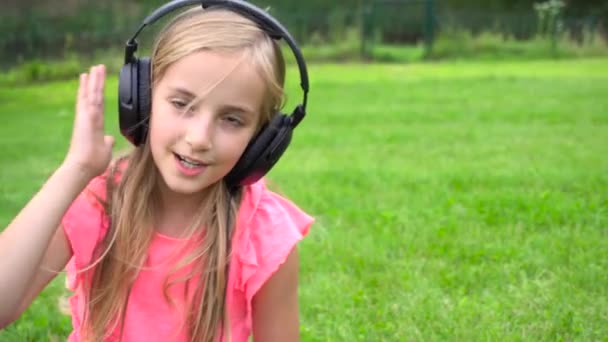 girl listen music on tablet outdoors