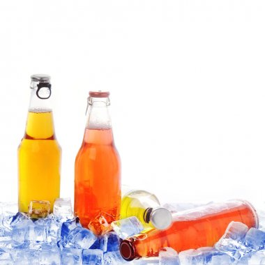 Bottles with drink in ice