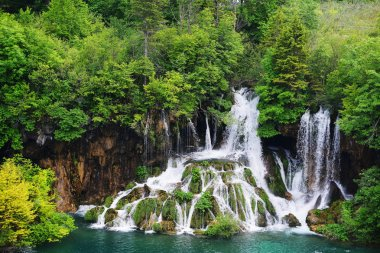waterfalls on slopes of mountains