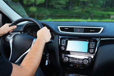 Male hands of steering wheel