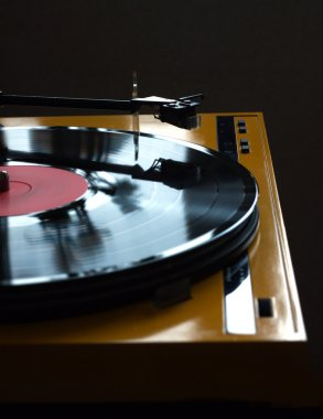 Turntable in yellow case side view isolated