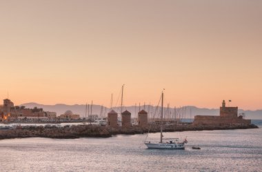 Mandraki Port at sunset from the windmills and the castle. The island of Rhodes. Greece