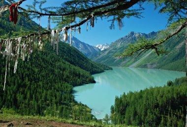 Mountain lake and buddhistic symbol
