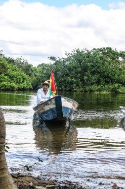 Boat Crossing the Amazon.