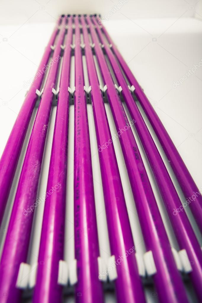 purple plastic pipes of underfloor heating system