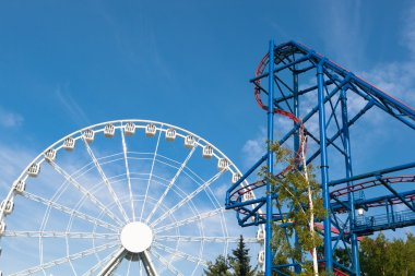 ferris wheel and roller-coaster in theme park