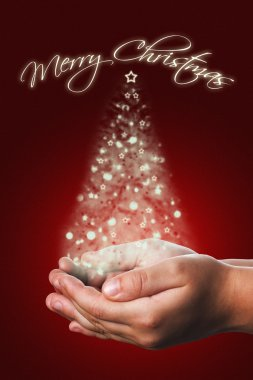 Christmas card with a child hands in red