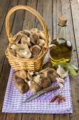 Fotografie Basket with mushrooms and ingredients for cooking