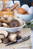 Fotografie King tumpet mushrooms on the table of the kitchen