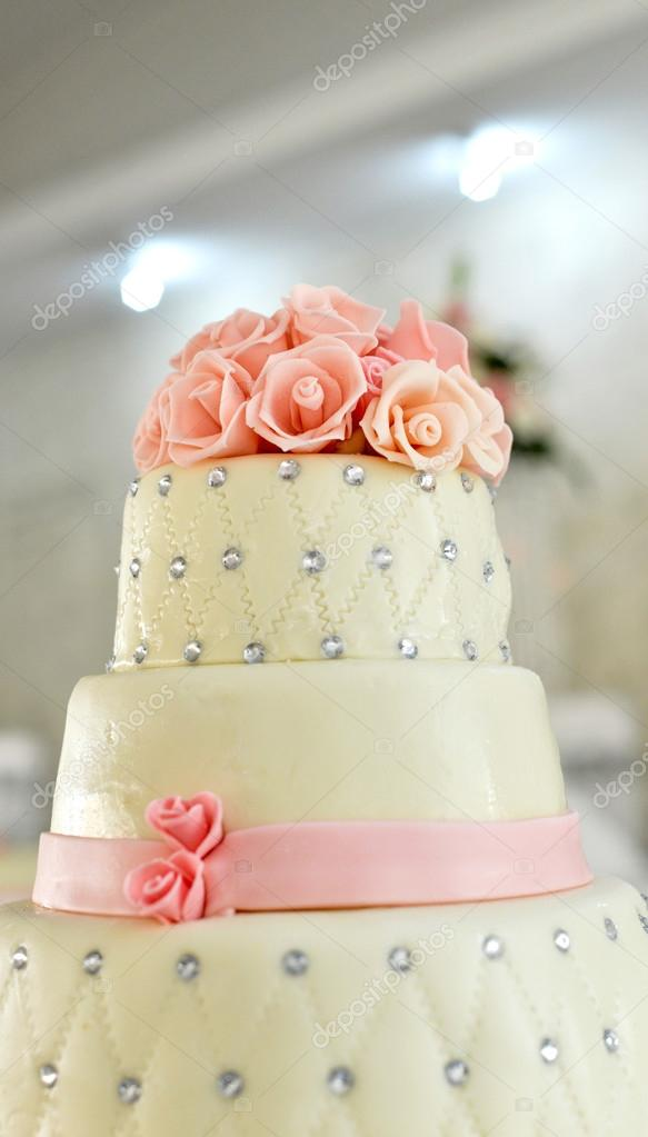 White wedding cake and pink flowers on top stock photo white wedding cake and pink flowers on top stock photo mightylinksfo